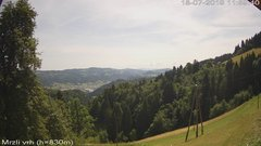 view from VREME ŽIRI-cam-3-VZHOD-Mrzli vrh on 2019-07-18